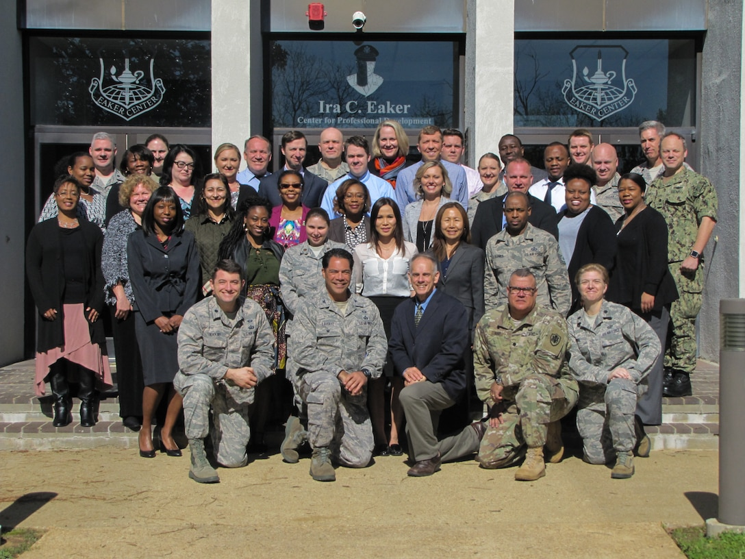 Lt. Col. David J. Ratliff, Ira C. Eaker Center for Professional Development instructor, (front row, far left) joins co-workers for a group photo. The Eaker Center is composed of four primary schools: Commanders' Professional Development School, U.S. Air Force Chaplain Corps College, Defense Financial Management and Comptroller School, and the AF Personnel Professional Development School. (Courtesy photo)