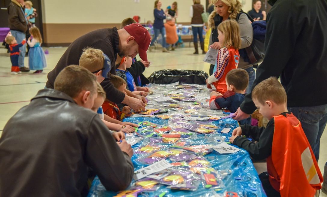 South Dakota National Guard members and their kids creates different masks during the Princess and Super Hero Day Camp April 7, 2018, at the National Guard Armory, Sioux Falls, S.D.