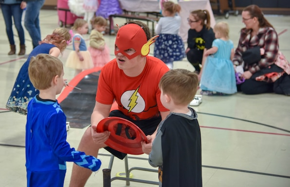 Brayden Frey, South Dakota National Guard Youth Council member, dressed up as the super hero Flash chats with kids during the Princess and Super Hero Day Camp April 7, 2018, at the National Guard Armory, Sioux Falls, S.D.