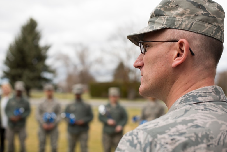 Col. Ryan Samuelson, 92nd Air Refueling Wing commander, speaks to Airmen during a base pinwheel ceremony in honor of Child Abuse Awareness Month at Fairchild Air Force Base, Washington, April 9, 2018. Airmen installed pinwheels at the base chapel to honor Child Abuse Awareness Month. (U.S. Air Force photo/Senior Airman Ryan Lackey)