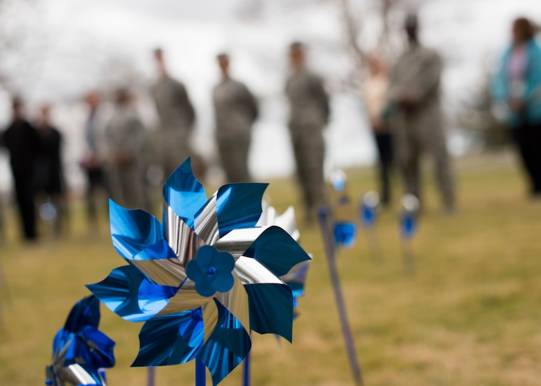 A pinwheel twirls in the wind on the chapel lawn during a pinwheel ceremony in honor of Child Abuse Awareness Month at Fairchild Air Force Base, Washington, April 9, 2018. Airmen placed  pinwheels at the base chapel to honor Child Abuse Awareness Month. (U.S. Air Force photo/Senior Airman Ryan Lackey)