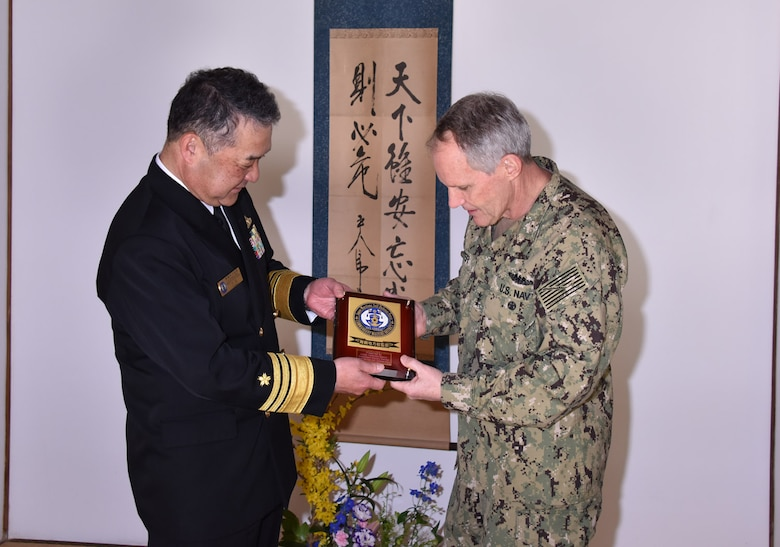 KYOTO, Japan (April 10, 2018) Vice. Adm. Phil Sawyer, commander, U.S. 7th Fleet, right, accepts a gift from Japan Maritime Self-Defense Force (JMSDF) Vice Adm. Takehisa Nakao, commandant of the JMSDF Maizuru District, during a visit to the Maizuru District headquarters in Kyoto. Sawyer visited Kyoto to reinforce 7th Fleet's close, long-standing partnership with the JMSDF throughout Japan.