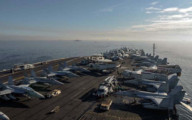 MANILA, Republic of the Philippines (April 11, 2018) The aircraft carrier USS Theodore Roosevelt (CVN 71) anchors off the coast of Manila, Republic of the Philippines for a scheduled port visit.  Theodore Roosevelt is deployed in the U.S. 7th Fleet area of operations in support of maritime security operations and theater security cooperation efforts.
