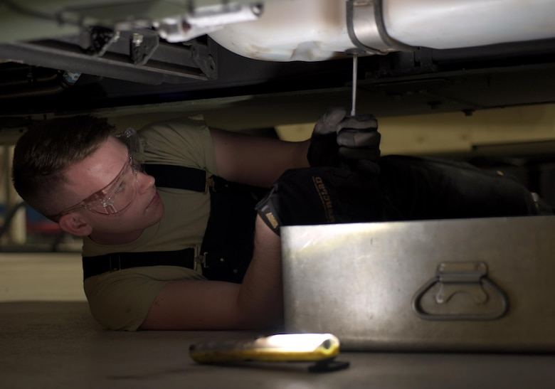 U.S. Air Force Airman 1st Class Joshua Patterson, 100th Logistics Readiness Squadron mission generating vehicular maintenance journeyman, prepares to empty the fuel tank of a Humvee at RAF Mildenhall, England, April 4, 2018. Vehicle maintenance teaches Airmen to develop troubleshooting and critical thinking skills to help them do their job. (U.S. Air Force photo by Airman 1st Class Benjamin Cooper)