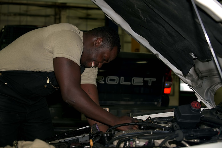 U.S. Air Force Staff Sgt. Markeith Roberson, 100th Logistics Readiness Squadron mission generating general purpose maintenance supervisor, works on an engine of a security forces vehicle at RAF Mildenhall, England, Jan. 29, 2018. Vehicle maintenance handles a wide variety of vehicles such as Humvees, cranes, vans and security forces vehicles. (U.S. Air Force photo by Airman 1st Class Benjamin Cooper)