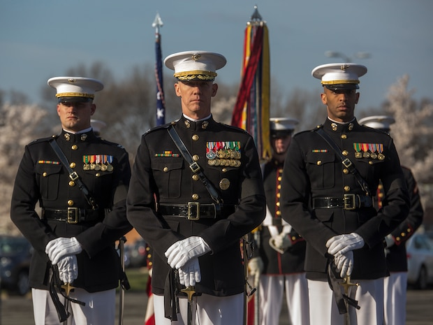 """Colonel Tyler J. Zagurski, center, commanding officer, Marine Barracks Washington D.C., Capt. Logan A. Giger, left, infantry officer, MBW, and Capt. Ryan Davis, logistics officer, MBW, stand at a ceremonial position during a full honors funeral for Maj. Gen. John A. Studds at Arlington National Cemetery, Arlington, Virginia, April 10, 2018. General Studds was commissioned into the Marine Corps in 1960 and served the following 33 years as an Infantry Officer. He commanded Marines at all levels including; Commander, Charlie Company, 3rd Reconnaissance Battalion in Vietnam where he received the Bronze Star with Combat """"V"""" for valor and was the Director of Marine Corps Intelligence during Operations Desert Shield and Desert Storm. Studds concluded his devout career as the Commanding General, Marine Corps Recruit Depot, San Diego."""