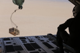 U.S. Marine Cpl. Lauren Song, an air crewman with Marine Aerial Refueler Transport Squadron 152, Marine Aircraft Group 12, 1st Marine Aircraft Wing, releases units of blood during an air delivery drop at Marine Corps Air Station Yuma, Ariz., March 28, 2018. There were five different packaging variations used for the air delivery. Each used materials from the Authorized Medical and Dental Allowance List and a special insulated box called a 'Collins' box; these variations also included numerous parachute configurations. The purpose of the exercise was to test the viability of blood samples being transported by air delivery.
