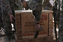 U.S. Marines with 1st Air Delivery Platoon, Landing Support Company, 1st Marine Logistics Group, prepares blood units in preparation of an air delivery at Marine Corps Air Station Yuma, Ariz., March 28, 2018. This training is intended to test the viability of dropping units of blood by air to austere environments when ground delivery is not an option.
