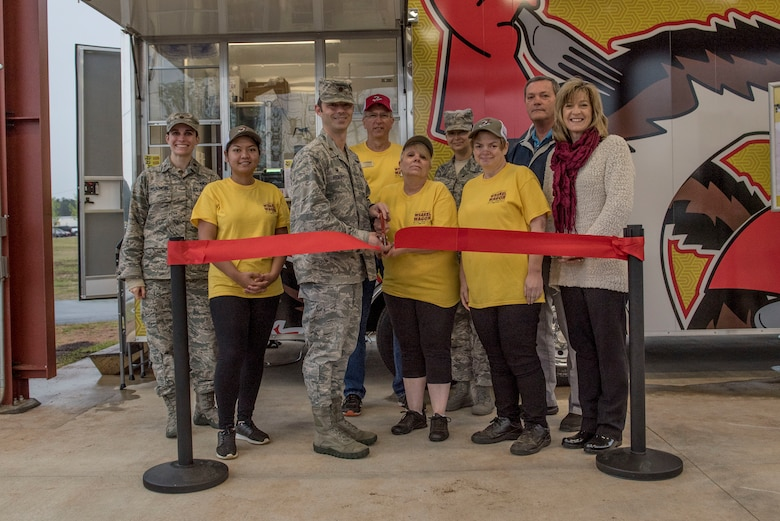Team Shaw members assigned to the 20th Force Support Squadron (FSS) cut the ribbon for the Weasel Wagon food trailer opening at Shaw Air Force Base, S.C., April 9, 2018.