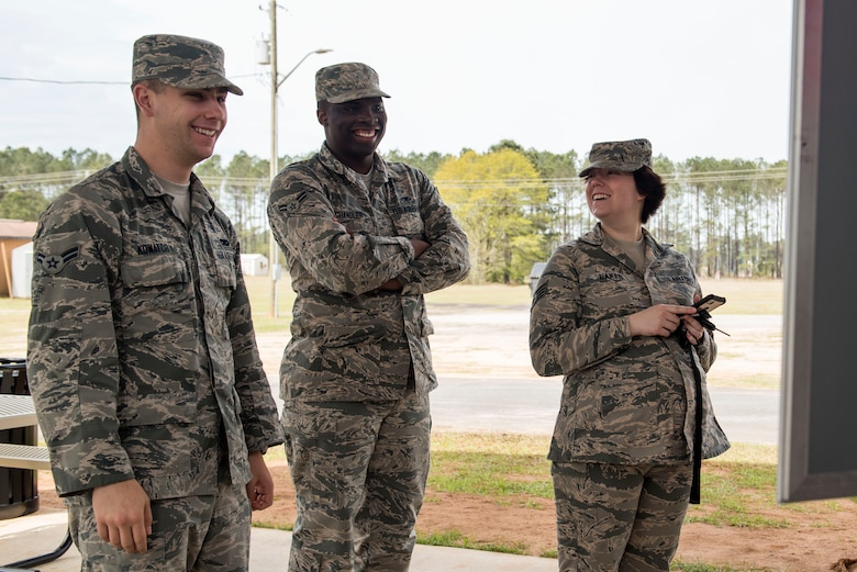 From left, U.S. Air Force Airmen 1st Class Tanner Kowatch, Justin Chandler and Staff. Sgt. Breonna Baker, 20th Maintenance Group maintenance analysts, decide on their orders while in line at the Weasel Wagon at Shaw Air Force Base, S.C., April 10, 2018.