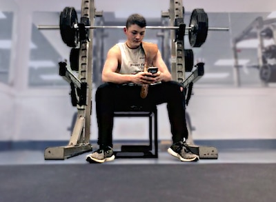 Airman works out in gym weight room.