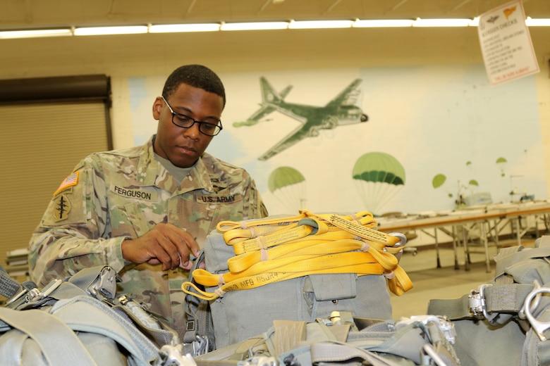 Parachute riggers focused on providing safe landings