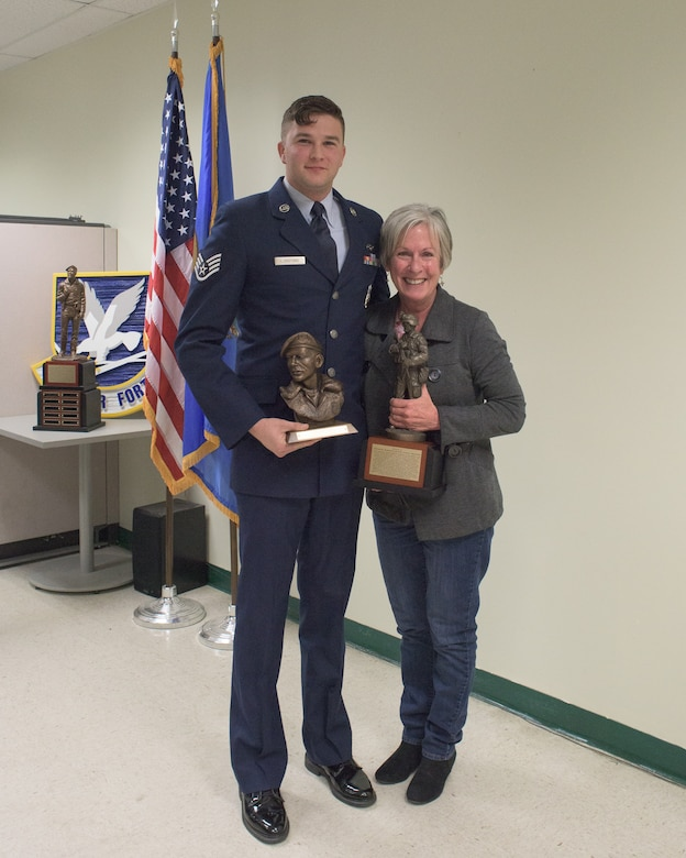 U.S. Air Force Staff Sgt. James Lunsford, 137th Special Operations Security Forces Squadron, poses with Phyllis Johnson, La Don Johnson's widow, after receiving the La Don Johnson Award during the first annual defender of the year award ceremony at Will Rogers Air National Guard Base in Oklahoma City, Feb. 3, 2018. The recipient of the award is chosen by peers of the 137 SOSFS Airmen for continued excellence in everyday duties. (U.S. Air National Guard photo by Tech. Sgt. Caroline Essex)
