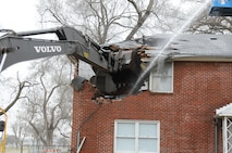 Crews began tearing down the housing units in Fort Riley's Colyer Manor March 29, 2018. More than 300 homes will be demolished and the work is anticipated to continue for the next year.
