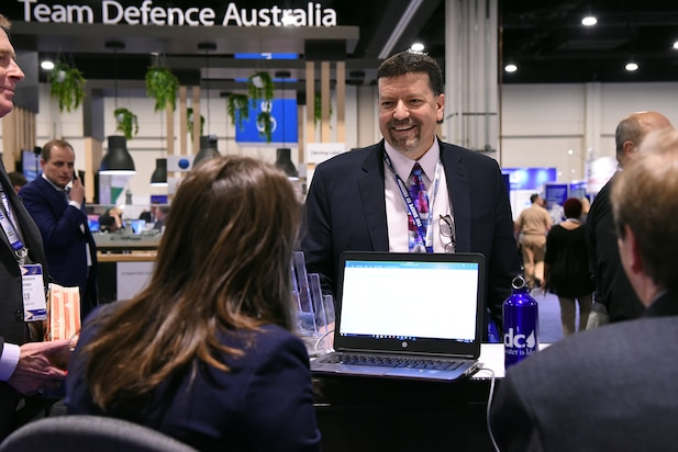 Mr. Jim Smerchansky, Executive Director, Naval Sea Systems Command (NAVSEA) stops by the NAVSEA booth during the 2018 Sea-Air-Space Exposition