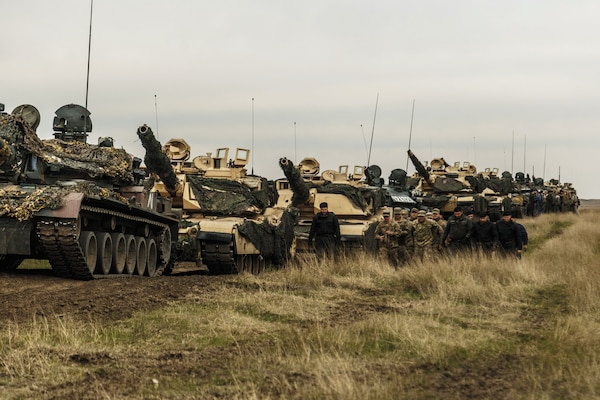 American M1 Abrams and Romanian TR-85 tanks and personnel on training ground in Romania as part of Operation Atlantic Resolve, supporting security and stability in Europe, April 2017 (NATO)