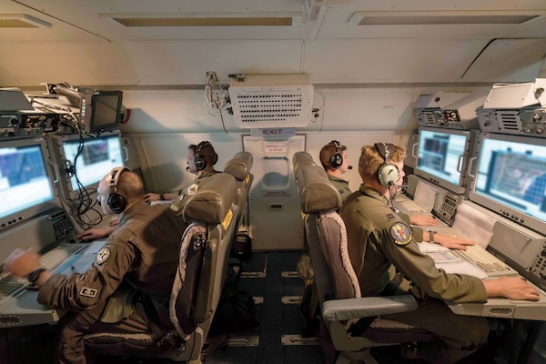 Airmen from 116th Air Control Wing, Georgia Air National Guard, monitor surveillance data while flying night mission aboard E-8C Joint STARS, Robins