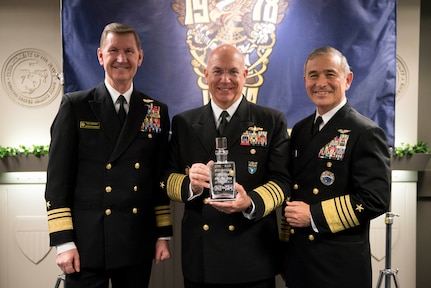 Navy leaders pose for a photo.