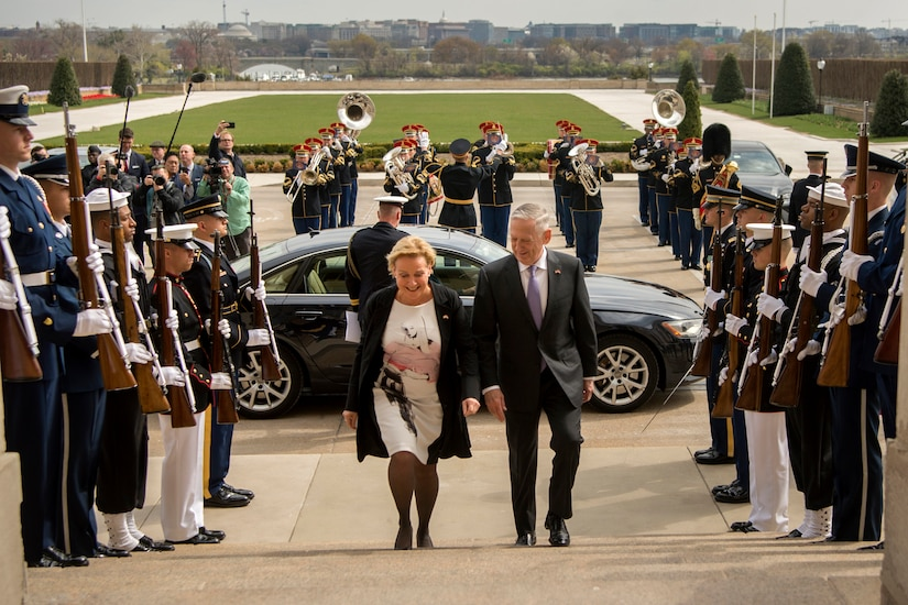 Defense Secretary James N. Mattis walks up the steps with the Dutch defense minister.