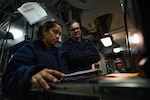 Information Systems Technicians monitor communication systems aboard USS Theodore Roosevelt, January 2018, Arabian Gulf (U.S. Navy/Alex Corona)