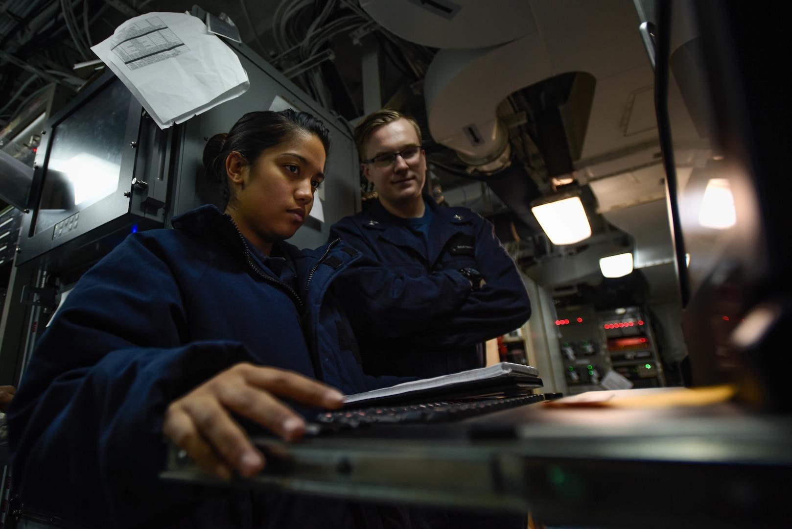 Information Systems Technicians monitor communication systems aboard USS Theodore Roosevelt, January 2018, Arabian Gulf (U.S. Navy/Alex Corona)