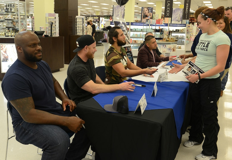 Ultimate Fighting Championship fighters and radio hosts meet with fans at the Exchange during a visit to Joint Base Langley-Eustis, Va., April 5, 2018.