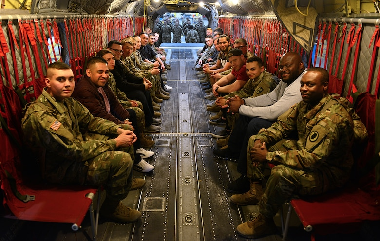 Ultimate Fighting Championship fighters and radio hosts sit inside a U.S. Army CH-47 Chinook helicopter with Soldiers from the 128th Aviation Brigade during a visit to Joint Base Langley-Eustis, Va., April 5, 2018.