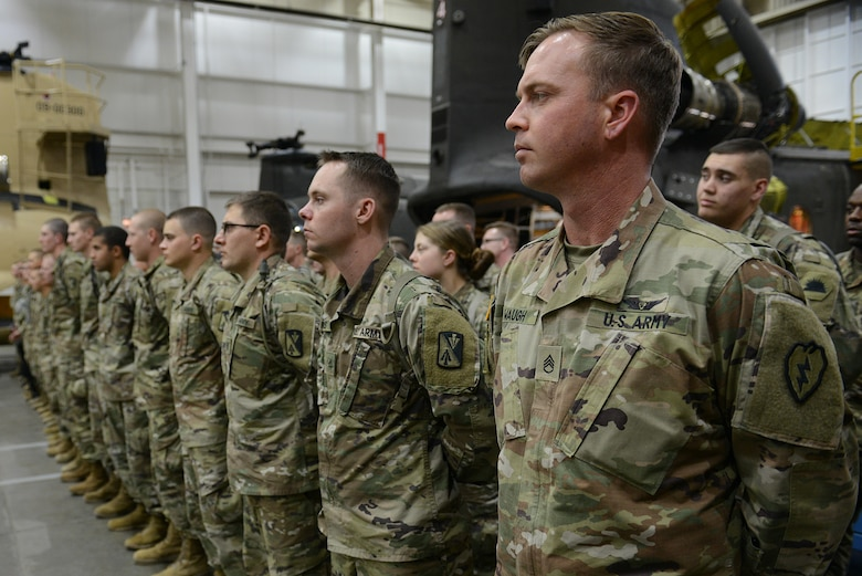 U.S. Army Soldiers from the 128th Aviation Brigade stand in formation during a visit from Ultimate Fighting Championship fighters and radio hosts at Joint Base Langley-Eustis, Va., April 5, 2018.
