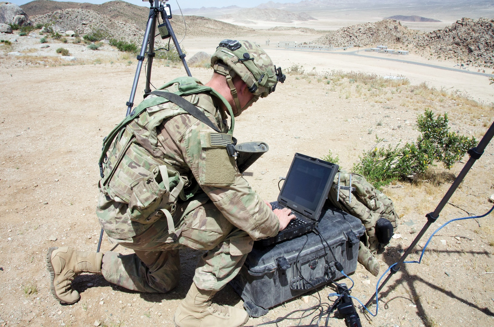 Soldier with 780th Military Intelligence Brigade sets up cyber tools overlooking mock city of Razish at National Training Center, Fort Irwin, California, May 5, 2017, as part of Army Cyber Command–led Cyber-Electromagnetic Activities Support to Corps and Below Initiative (U.S. Army Cyber Command/Bill Roche)
