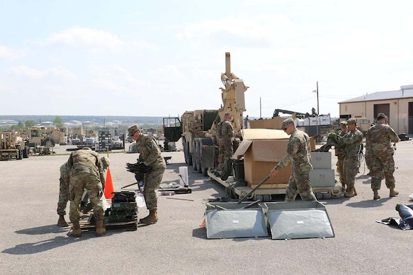 Soldiers unload serviceable equipment onto pallets for turn in to Sierra Army Depot that will be inventoried back into the Global Combat Support System.