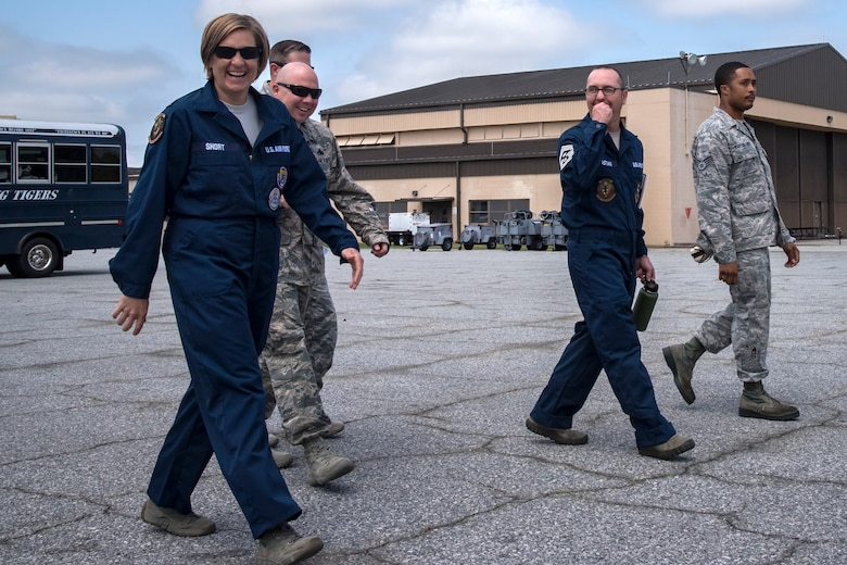 Airmen from the 23d Aircraft Maintenance Squadron (AMXS) and leadership from the 23d Wing, walk the flight line during an immersion tour, April 9, 2018, at Moody Air Force Base, Ga. Moody's leadership toured the 23d AMXS to get a better understanding of their overall mission, capabilities, and comprehensive duties. (U.S. Air Force photo by Airman Eugene Oliver)
