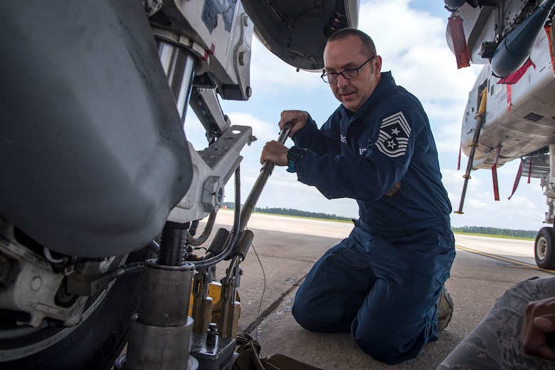 Chief Master Sgt. Jarrod Sebastian, 23d Wing command chief, pushes down on a tire jack during an immersion tour, April 9, 2018, at Moody Air Force Base, Ga. Moody's leadership toured the 23d Aircraft Maintenance Squadron to get a better understanding of their overall mission, capabilities, and comprehensive duties. (U.S. Air Force photo by Airman Eugene Oliver)