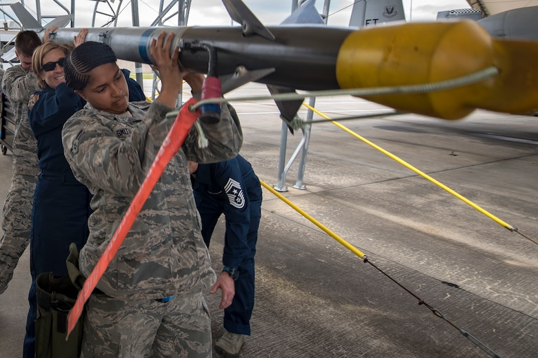 Col. Jennifer Short, middle, 23d Wing commander, and Airmen from the 23d Aircraft Maintenance Squadron (AMXS) carry an AIM-9 air to air missile during an immersion tour, April 9, 2018, at Moody Air Force Base, Ga. Moody's leadership toured the 23d AMXS to get a better understanding of their overall mission, capabilities, and comprehensive duties. (U.S. Air Force photo by Airman Eugene Oliver)