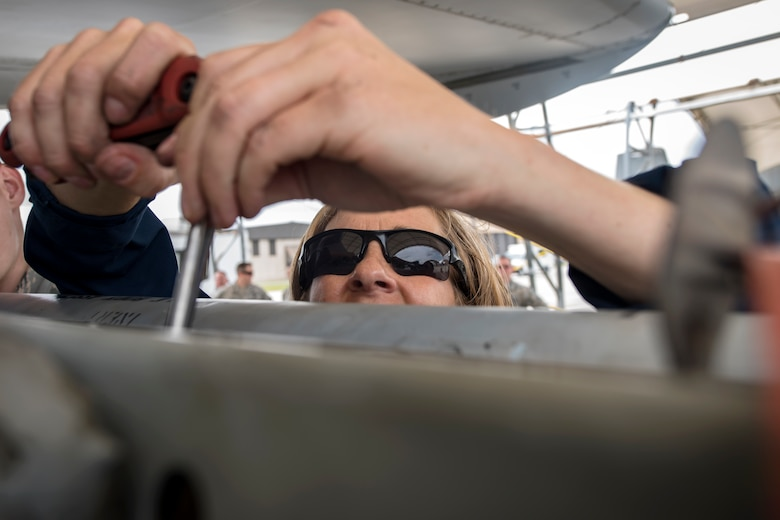 Col. Jennifer Short, 23d Wing commander, screws a component into an A-10C Thunderbolt II during an immersion tour, April 9, 2018, at Moody Air Force Base, Ga. Moody's leadership toured the 23d Aircraft Maintenance Squadron to get a better understanding of their overall mission, capabilities, and comprehensive duties. (U.S. Air Force photo by Airman Eugene Oliver)