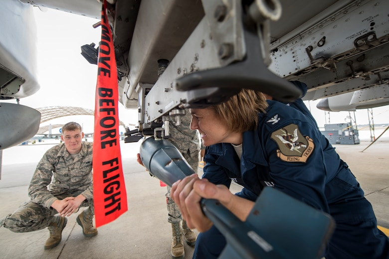 Col. Jennifer Short, right, 23d Wing commander, attempts to install a training munition onto an A-10C Thunderbolt II during an immersion tour, April 9, 2018, at Moody Air Force Base, Ga.  Moody's leadership toured the 23d Aircraft Maintenance Squadron to get a better understanding of their overall mission, capabilities, and comprehensive duties. (U.S. Air Force photo by Airman Eugene Oliver)
