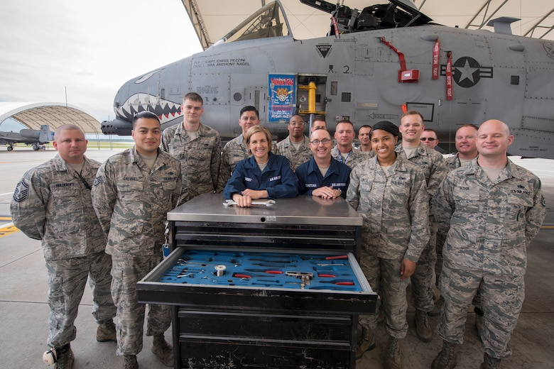 Airmen from the 23d Aircraft Maintenance Squadron (AMXS), pose for a photo with Col. Jennifer Short, 23d Wing (WG) commander and Chief Master Sergeant Jarrod Sebastian, 23d WG command chief, following an immersion tour, April 9, 2018, at Moody Air Force Base, Ga. Moody's leadership toured the 23d AMXS to get a better understanding of their overall mission, capabilities, and comprehensive duties.  (U.S. Air Force photo by Airman Eugene Oliver)