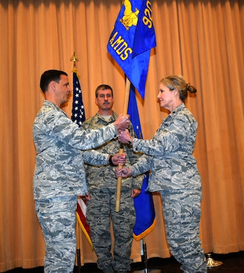 Lt. Col. Robyn Caudle accepts the 920th Aerospace Medicine Squadron (AMDS) guidon from Col. Ian Chase, 920th Rescue Wing vice commander during an assumption of command ceremony on Sunday, April 8 at Langley Air Force Base, Virginia.