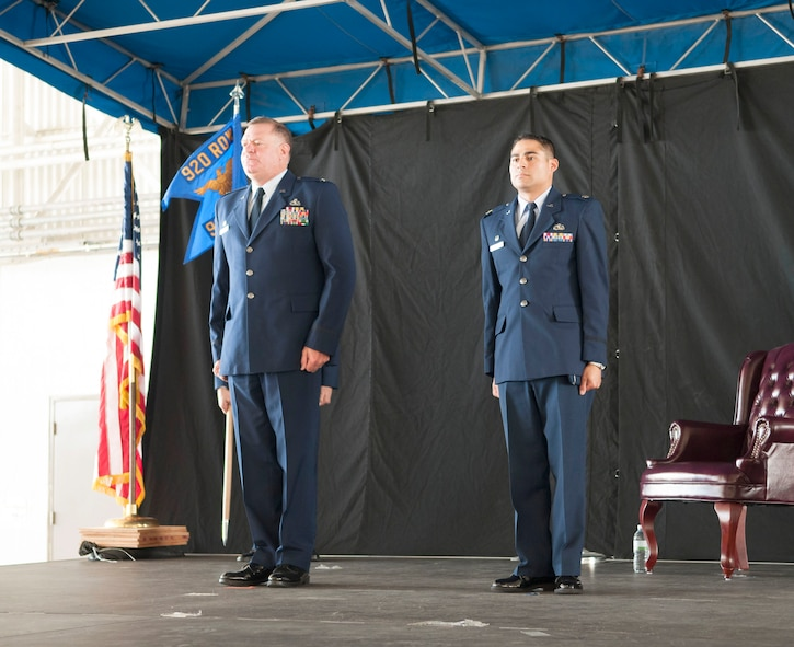 Col. Leo J. Kamphaus, Jr., commander of the 920th Maintenance Group and Maj. Chad P. Fuentes, commander of the 920th Aircraft Maintenance Squadron stand at attention during the 920th AMXS assumption of command ceremony.
