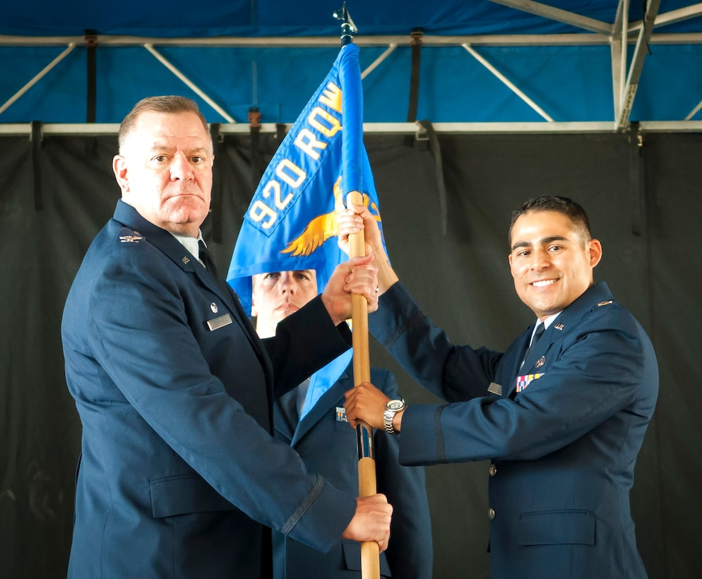 Col. Leo J. Kamphaus, Jr., commander of the 920th Maintenance Group and Maj. Chad P. Fuentes, commander of the 920th Aircraft Maintenance Squadron (AMXS) both hold the 920th Aircraft Maintenance Squadron guidon during the 920th AMXS assumption of command ceremony.