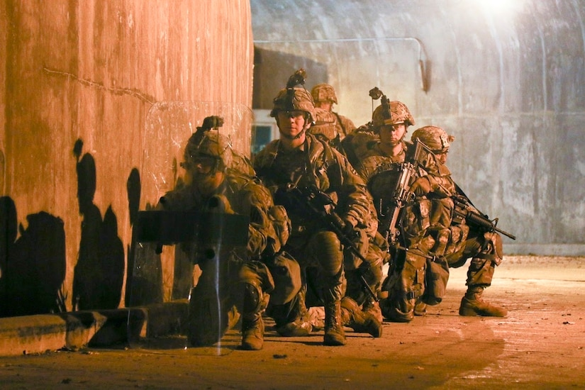 Soldiers rush toward an objective during battle drills.