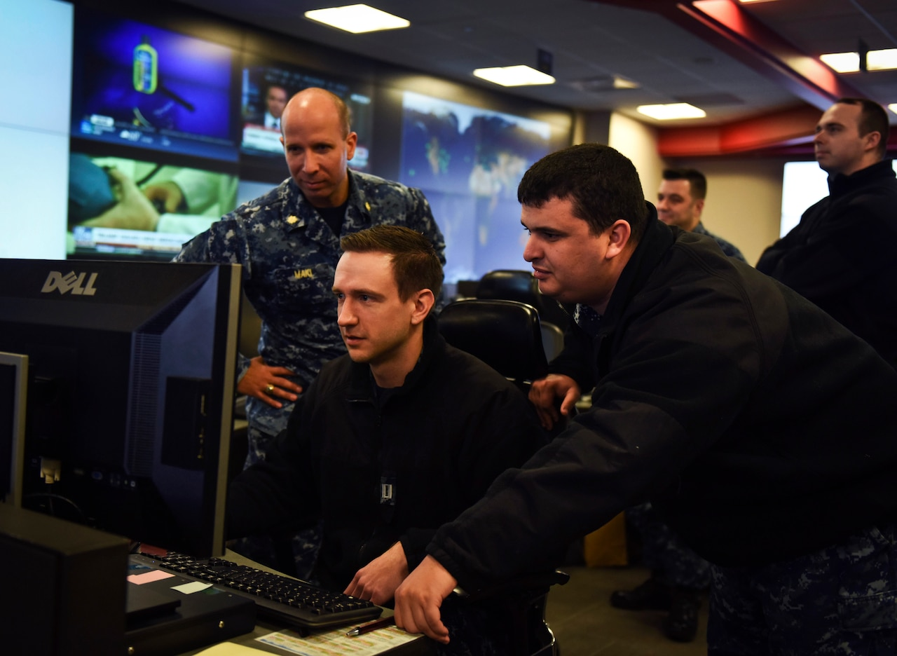 Sailors stand watch in the Fleet Operations Center at the headquarters of U.S. Fleet Cyber Command/U.S. 10th Fleet, Fort Meade, Maryland.