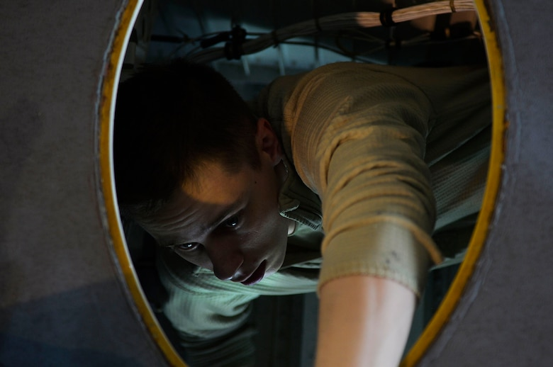 U.S. Air Force Airman 1st Class Kyle Brosa, 86th Maintenance Squadron fuel specialist, climbs out of the wing of a C-130J Super Hercules during an isochronal inspection on Ramstein Air Base, Germany, April 10, 2018. Inspections can last from several days to two weeks depending on what is being done. (U.S. Air Force photo by Senior Airman Joshua Magbanua)