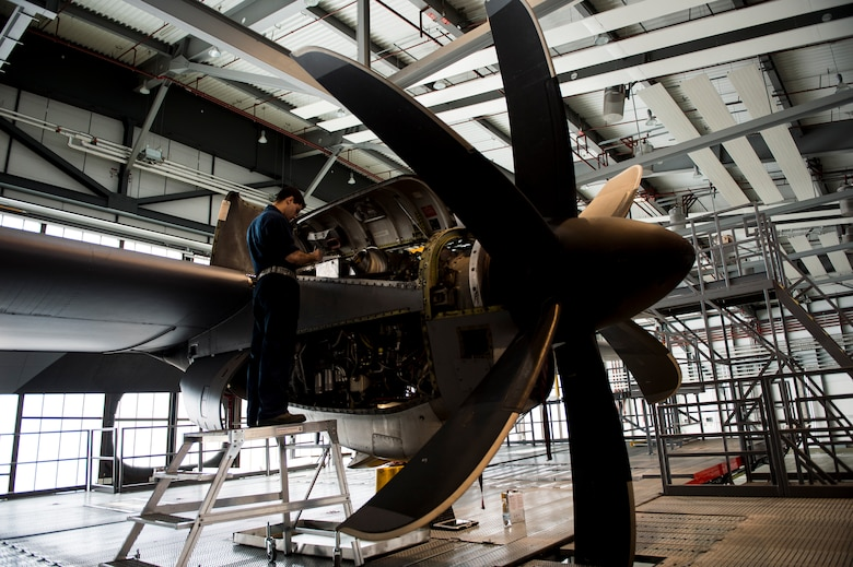 U.S. Air Force Senior Airman Johann Caballero, 86th Maintenance Squadron aerospace propulsion journeyman, performs maintenance on the engine of a C-130J Super Hercules on Ramstein Air Base, Germany, April 10, 2018. The most thorough kinds of inspections involve cleaning and opening the aircraft, and repairing or replacing parts as needed. (U.S. Air Force photo by Senior Airman Joshua Magbanua)