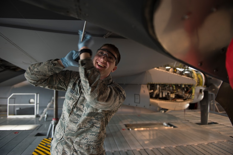 U.S. Air Force Senior Airman Joshua Rice, 86th Maintenance Squadron crew chief, unscrews a panel from a C-130J Super Hercules during an isochronal inspection on Ramstein Air Base, Germany, April 10, 2018. Isochronal inspections ensure aircraft remain reliable and operational for the Air Force's missions. (U.S. Air Force photo by Senior Airman Joshua Magbanua)