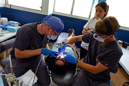 Military dentists treat a patient in Guatemala.