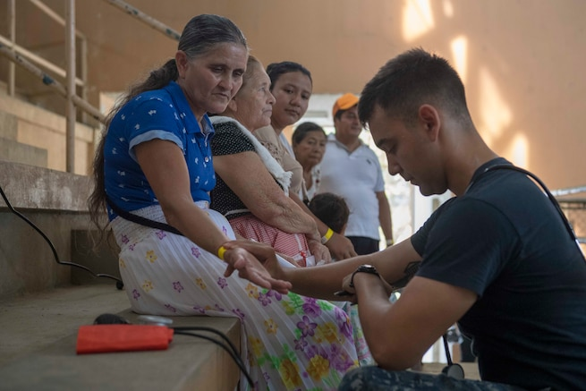 A doctor checks a patient in Guatemala