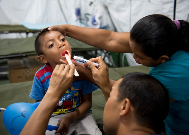 Doctors check a patient in Guatemala.