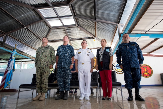 Military leaders stand in formation.