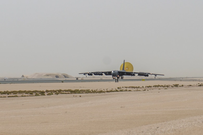 A B-52 Stratofortress aircraft assigned to the 69th Expeditionary Bomb Squadron lands at Al Udeid Air Base, Qatar, April 8, 2018, signifying the completion of its last sortie here before turning over the bomber mission to the newly arrived B-1B Lancer.  Since its arrival in 2016, the BUFF flew more than 1,800 sorties and employed nearly 12,000 weapons against ISIS and Taliban targets. (U.S. Air Force photo by Staff Sgt. Patrick Evenson)