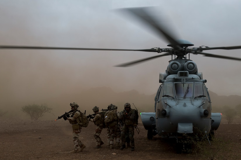 Air Force pararescuemen assigned to 48th Rescue Squadron and French air commandos provide cover after moving simulated patient into Eurocopter EC-725 for aerial transport during personnel recovery scenario in southern Arizona, November 7, 2017, as part of Angel Thunder (U.S. Air Force/Andrew Lee)